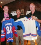 LNAH president Michel Gaudin, River Kings owner Bernie Villeneuve and head coach Al Wagar show off the new team colours.